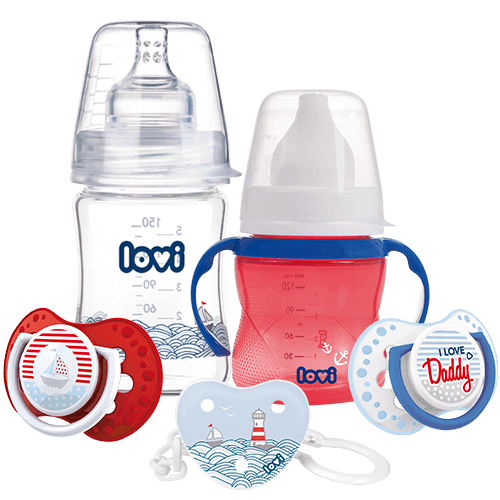 A set of LOVI Products - a glass feeding bottle, red training cup, two soothers one red one blue with white stripes and a soother holder with a sea and lighthouse print