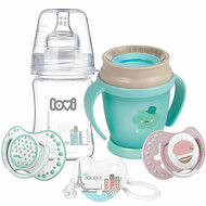 A set of LOVI Products from the Retro Baby Collection - A glass bottle, mint 360 cup, white and pink soother and soother holder with a panorama of Paris